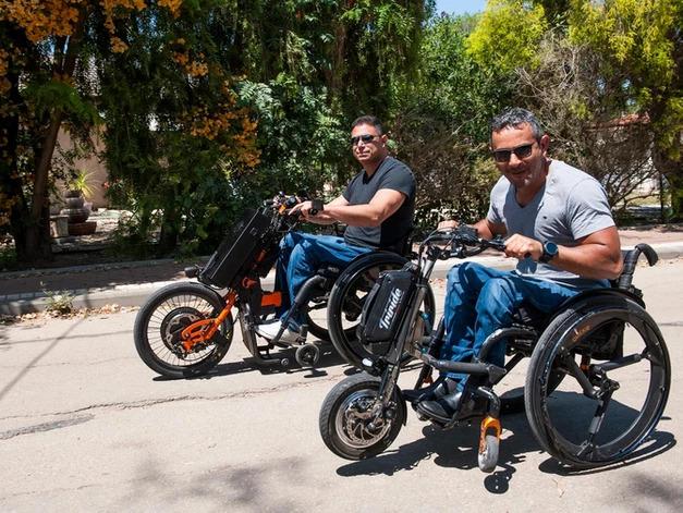 Guys with hand bikes and SoftWheel wheels