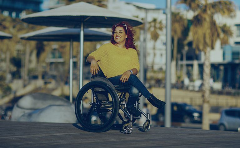 A girl on her wheelchair with SoftWheel wheels