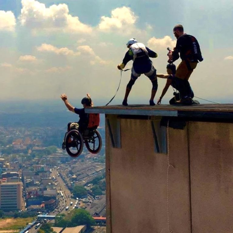 Man base jumping with wheelchair and SoftWheel wheels
